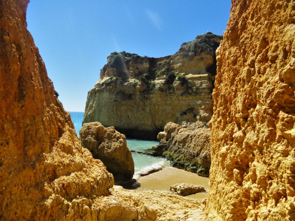 Orange rocks and cliffs on Algarve coast of Portugal