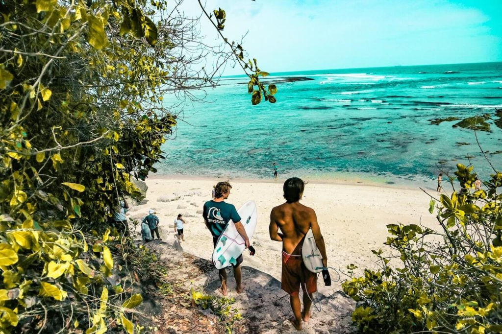 Surfers on the beach in Bali, travel guide