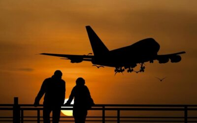 Plane in the sky during sunset, packing tips for flights