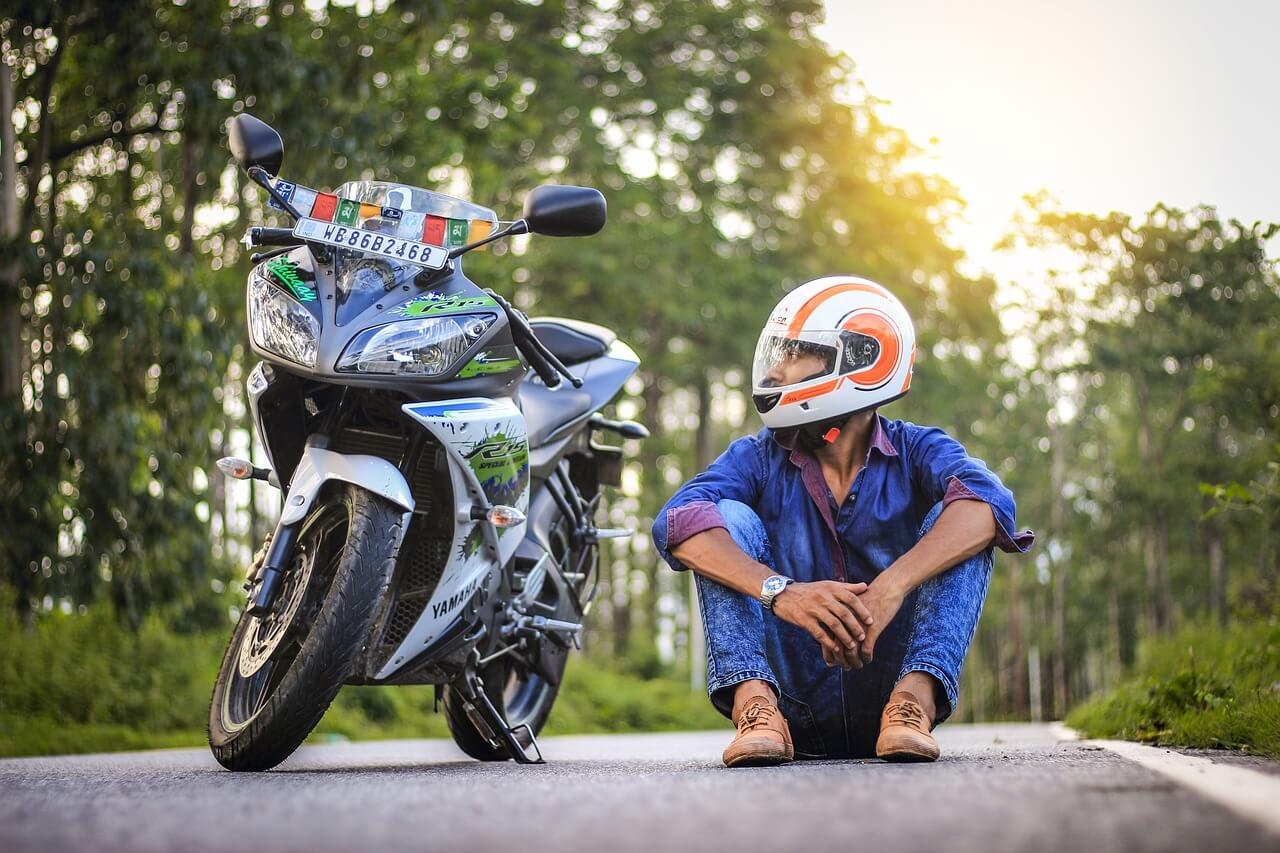 Biker sitting on the road, motorcycle gear