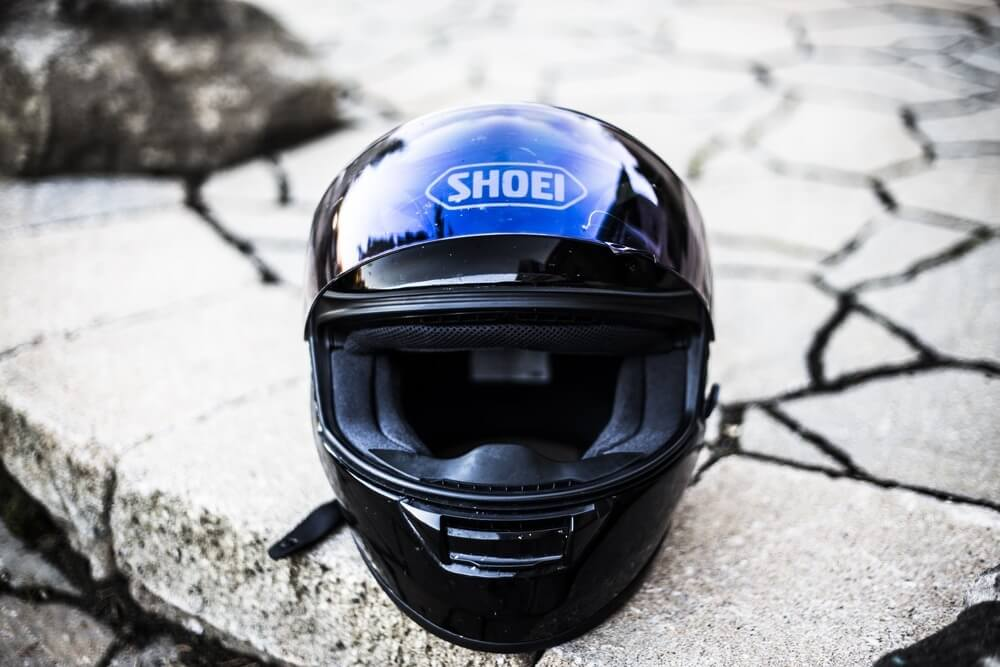 Helmet on the road, motorcycle gear to buy