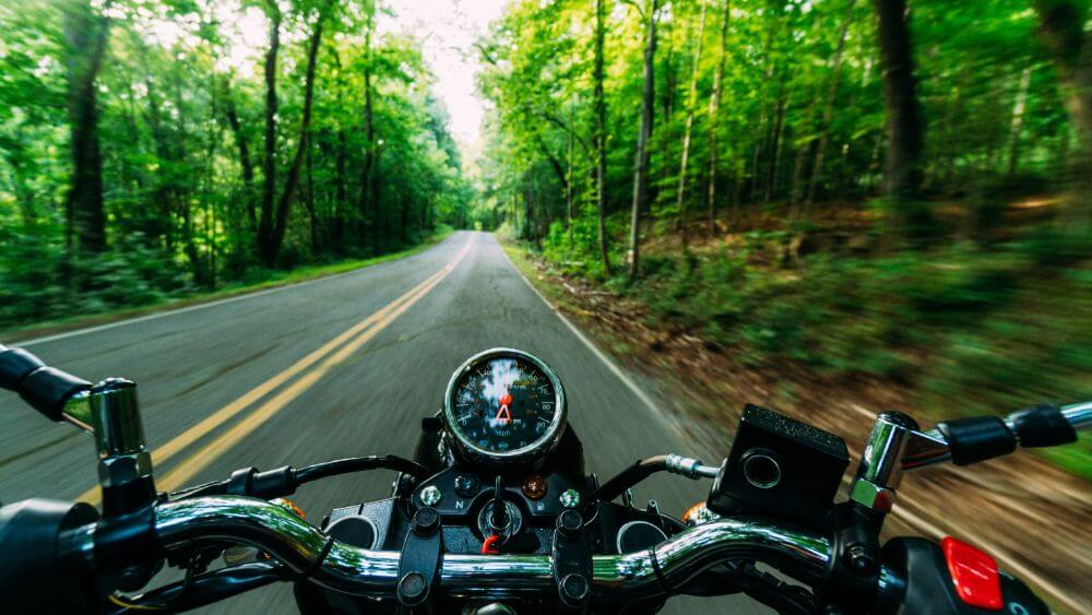 Bike road trip packing accessories list, riding on a forest road