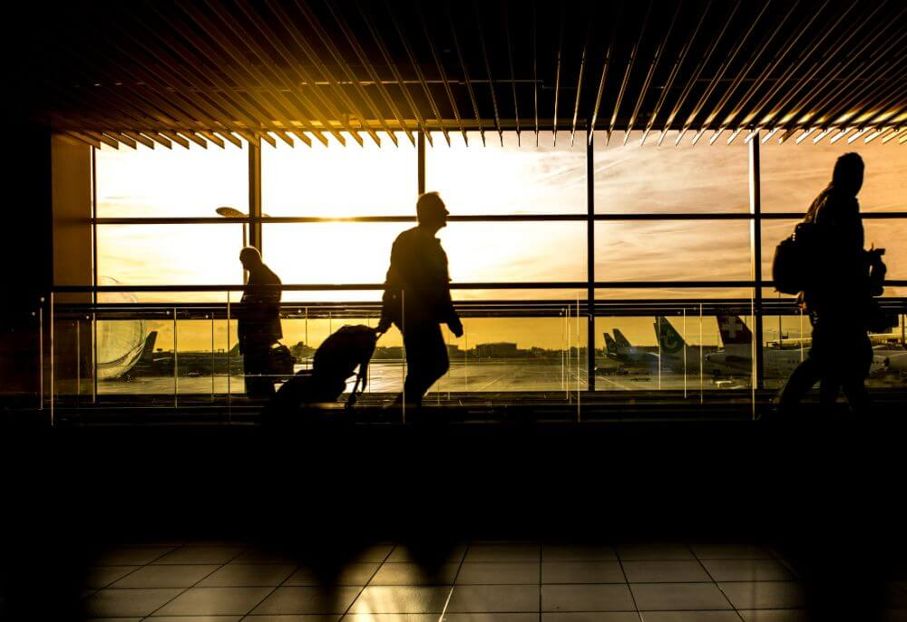 Man silhouette in the airport, business travel packing tips