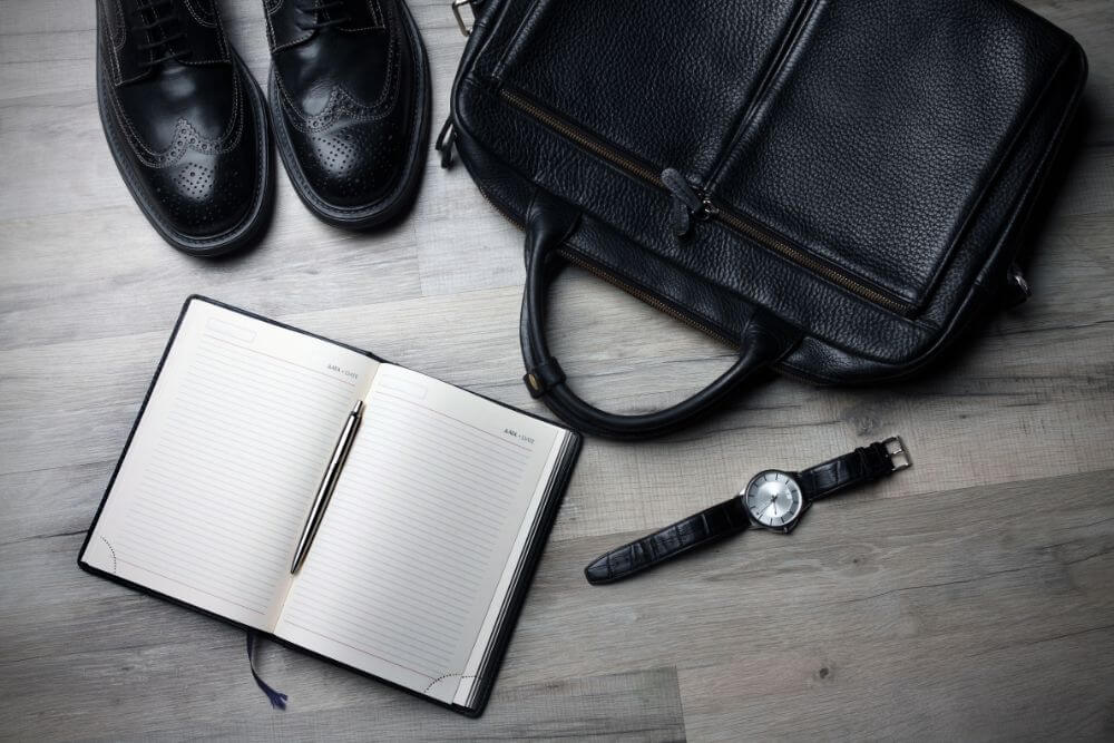 Notebook, watch, shoes and a bag, businessman items for a business trip