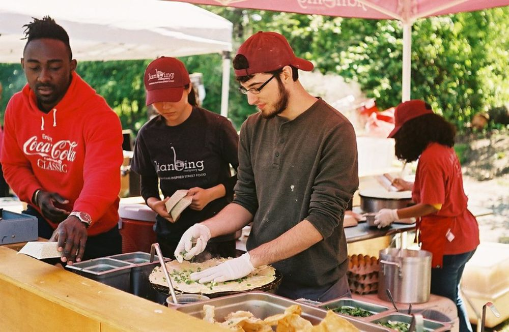 Making food in the Smorgasburg market in New York City