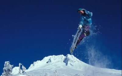 Snowboarer making tricks in French mountain ski resorts