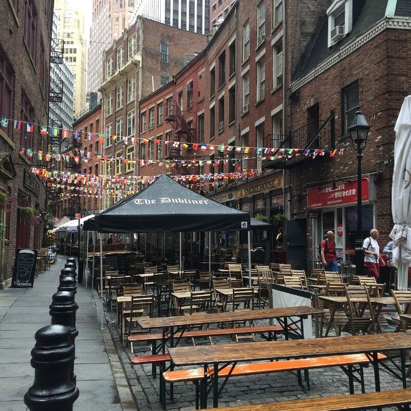 Outdoor dining street with bars and restaurants in New York City