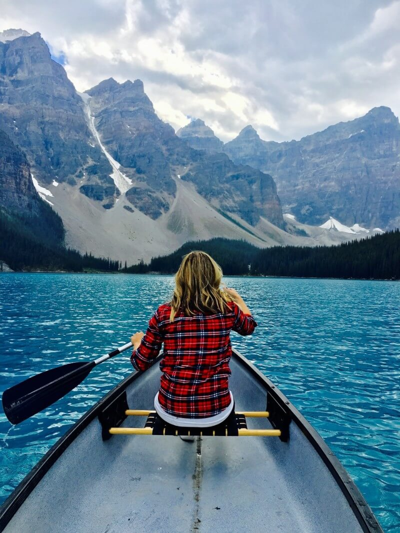 Moraine Lake kayaking between mountains near Banff outdoors