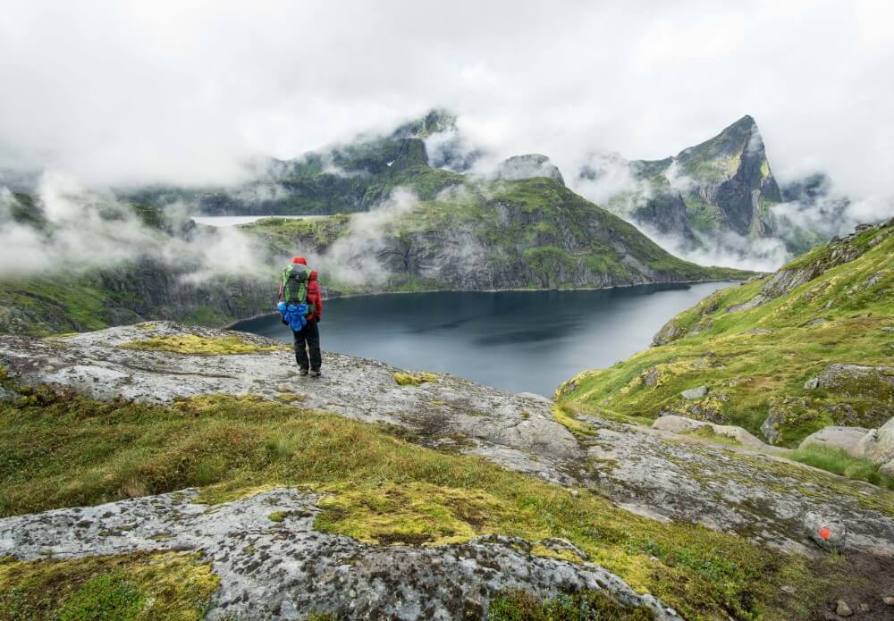Norway hiking in the mountains with full backpack of items