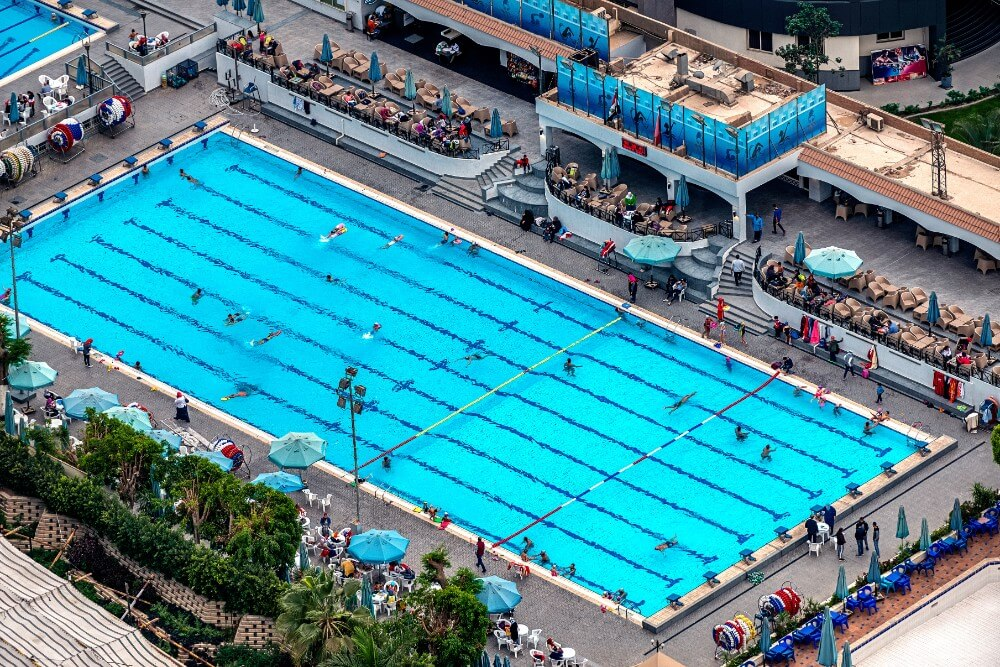 Large open public swimming pool from above bird eye view