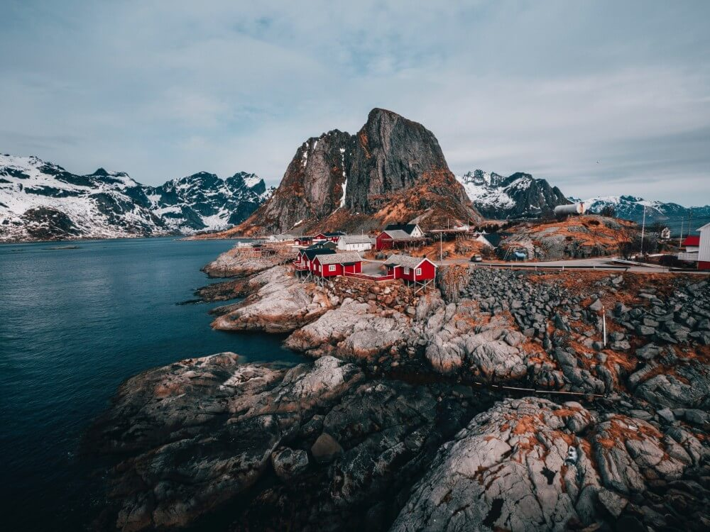 Small red houses on rocks and fjords in Norway, weekend itinerary