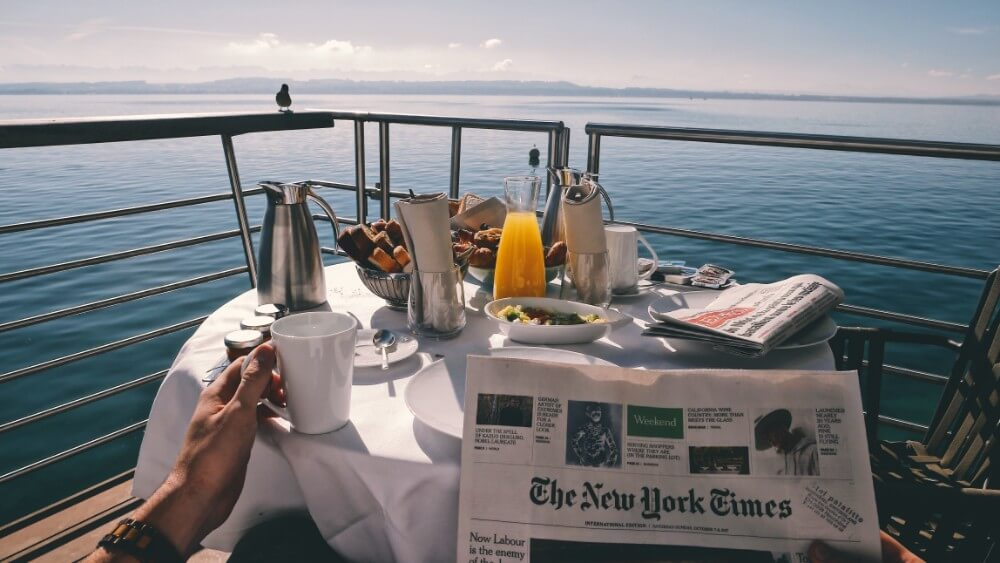 Breakfast and newspaper on a boat in the sea