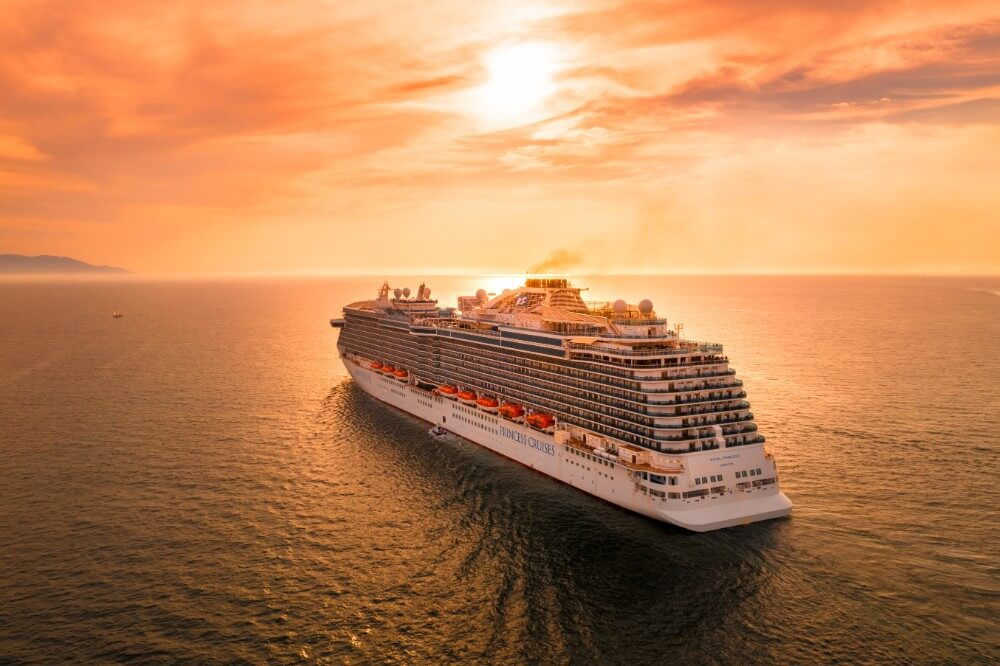 Cruise ship for family vacation sailing into the sunset