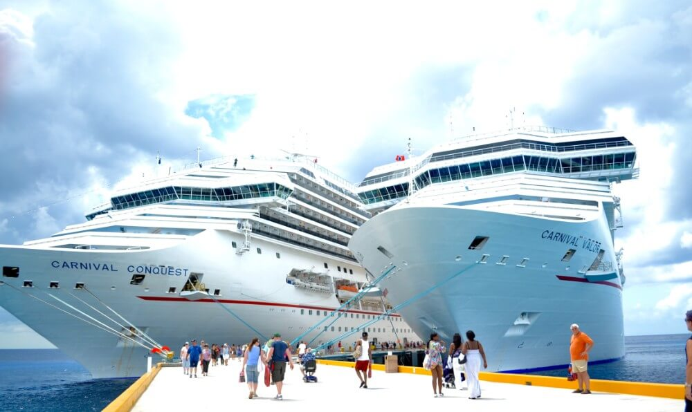Large cruise ships with people onboarding