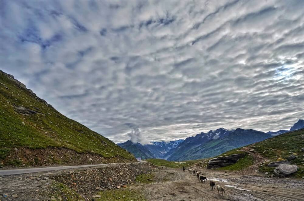 Volcano surrounded with clouds in the Rohtang Pass in Indian Himalayas