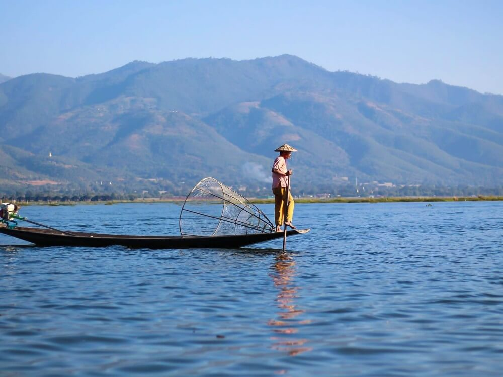Person on a boat in Inle Lake, Myanmar place to visit