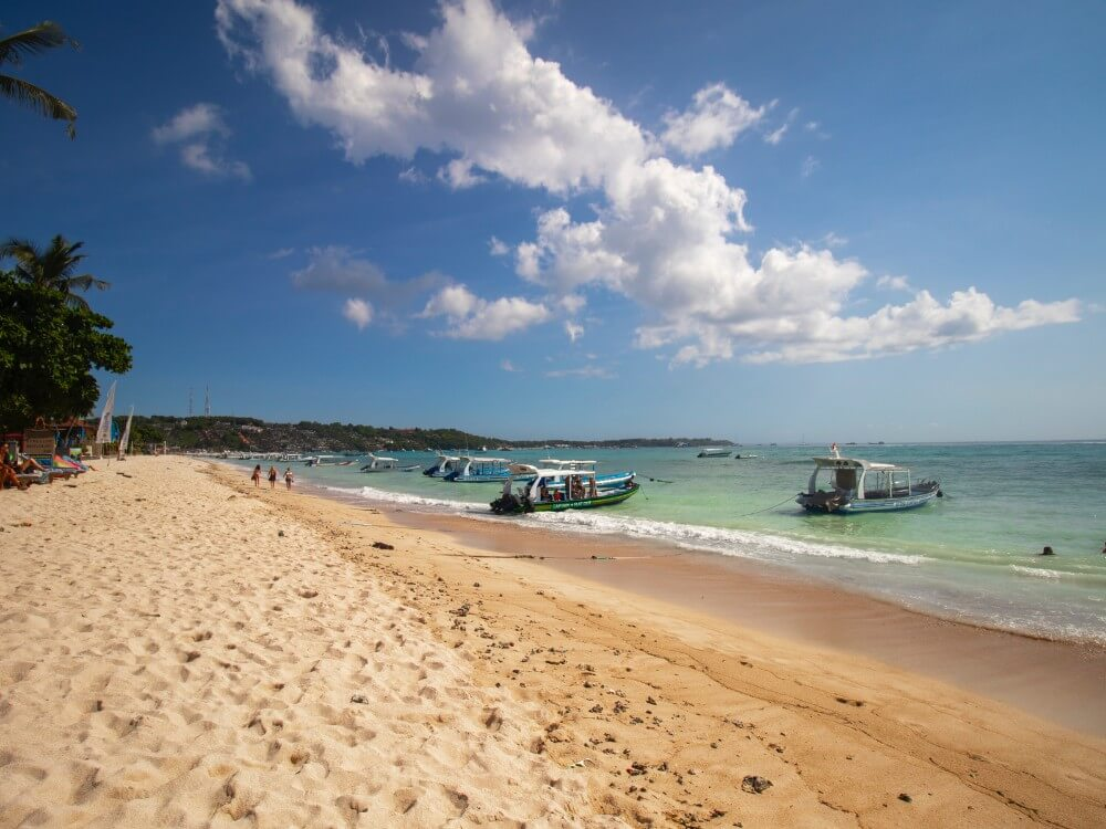 Nusa island deserted beach with boats in Southeast Asia