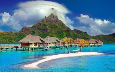 Beautiful beach, traditional houses and high mountains in Bora Bora island in Indonesia