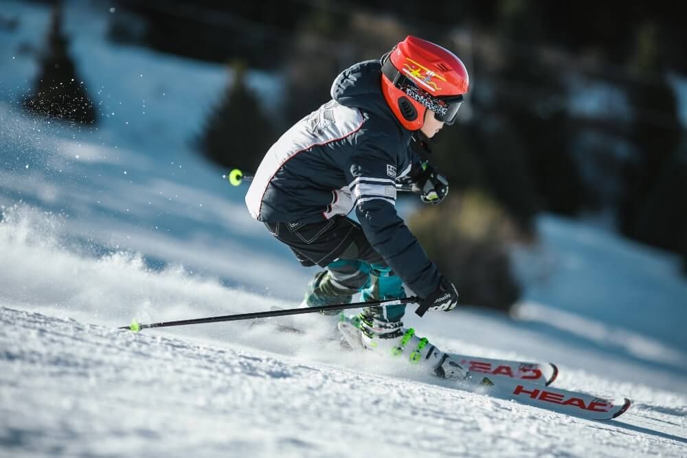 Boy skier skiing down the mountains in Sweden near Stockholm